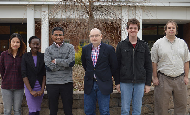 Computer science assistant professor Aravind Prakash, third from the left, with a group of students currently working in his lab.