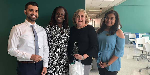 From left, Zeeshan Khalid, pharmacy manager at Wegmans; Angela Riley, executive director of experiential education and assistant dean; Pamela Krolczyk, supervising pharmacist at Wilson Place Pharmacy; and Sara Spencer, coordinator of introductory pharmacy practice experiences.