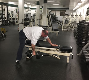Bill Clark is training for his next Guinness World Book attempt: most one-armed dumbbell rows in a minute! Note that he must follow Guinness' rules regarding technique.
