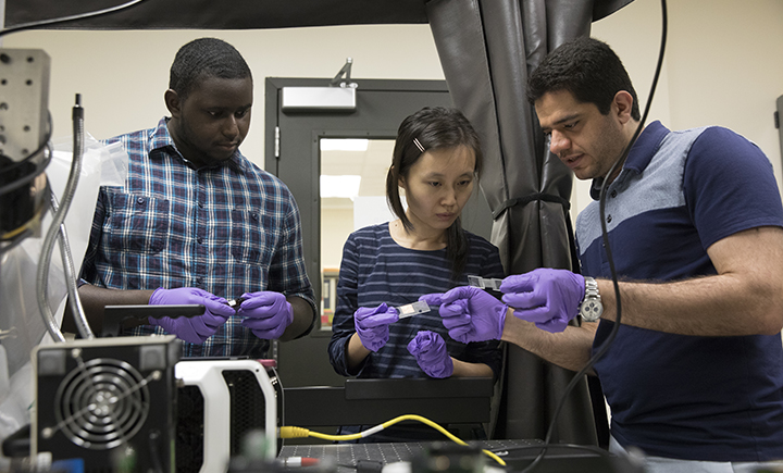 Assistant professor Congrui Jin (center) with two Binghamton University graduate students from the Mechanical Engineering Department.