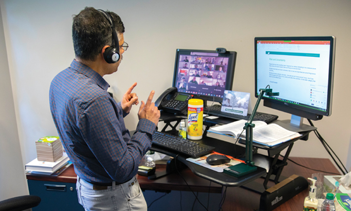 Subimal Chatterjee teaches an online class from his office in Academic A in April 2020.