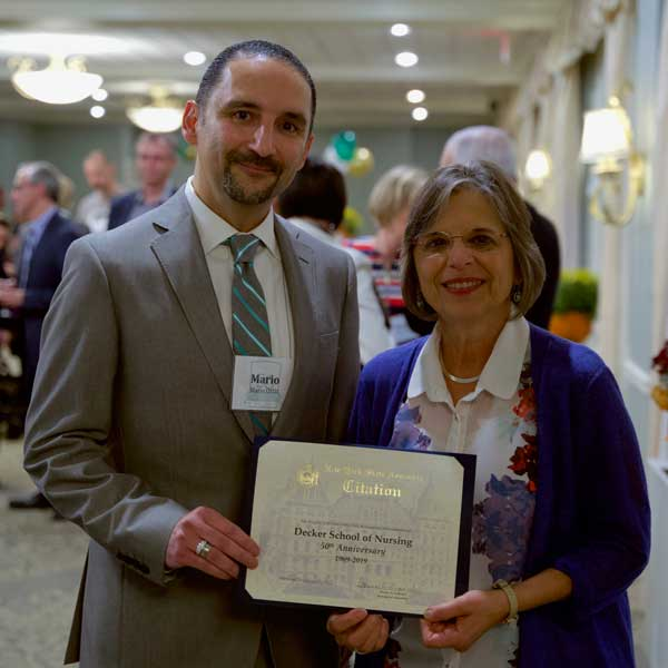 Assemblyperson Donna Lupardo presented Decker College Dean Mario Ortiz with a proclamation to recognize the school's 50 years of excellence and achievement.