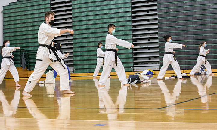 """John Fletcher, whose taekwondo classes were held in person in fall 2020, admitted that it's difficult to work out in a mask. """"But I was so impressed with the students who kept showing up to class,"""
