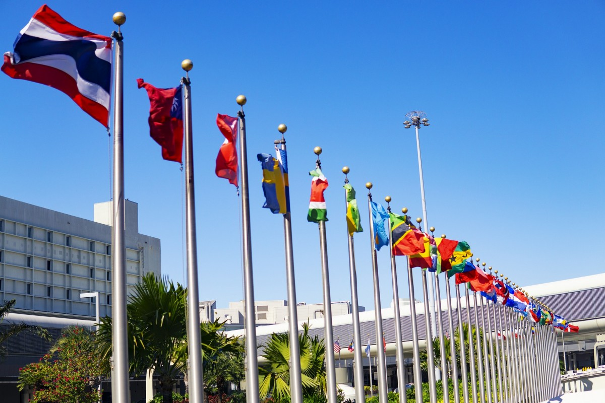 International flags flying outside a meeting of the United Nations.