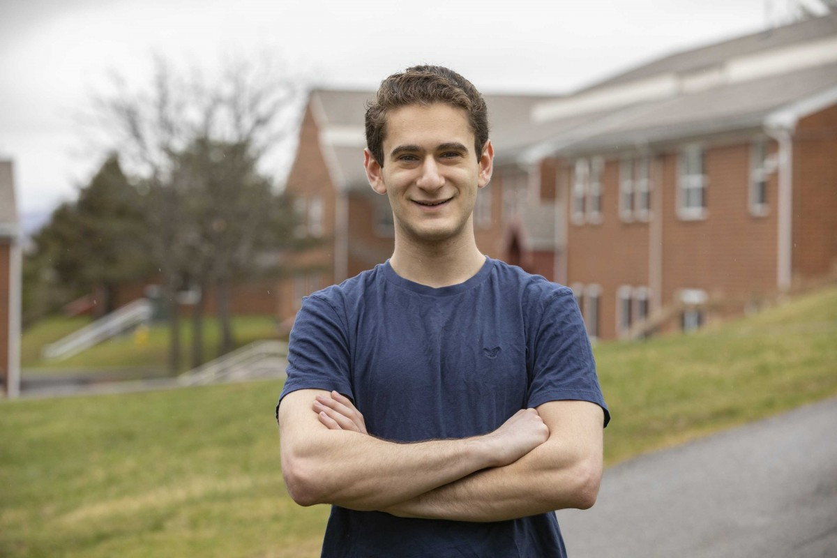 Jacob Goodman stands outside the Hillside Community, where he is currently residing on campus.