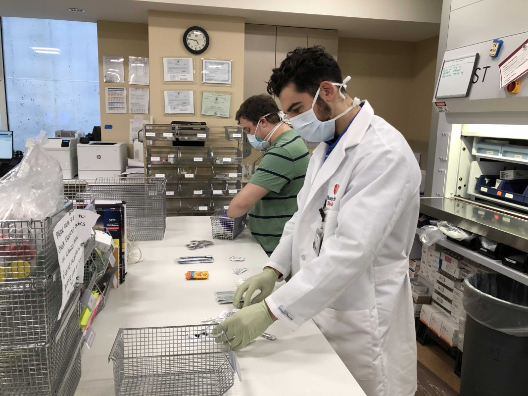 Pharmacy student Joseph D'Antonio works in Stony Brook University Hospital's pharmacy.