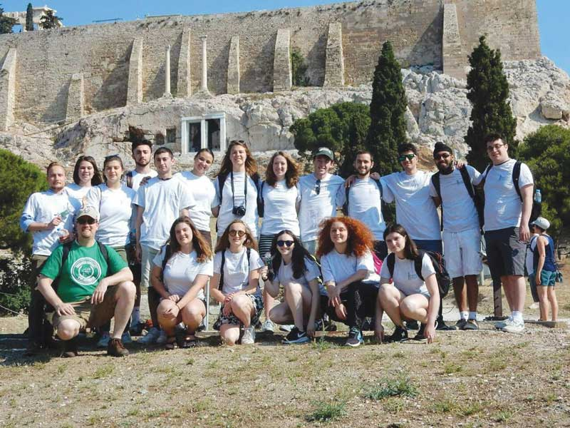 Kent Schull (in green) and his students visit the Acropolis in Greece.
