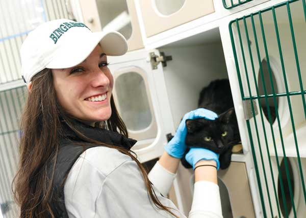 """Socialization"" is just a fancy word for making friends. Shayna Pedone '15 was one of the volunteers helping at the Animal Care Centers of NYC site in Manhattan."