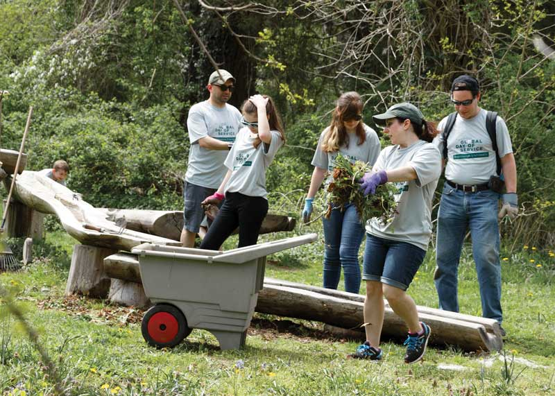 Volunteers prepare gardens at Sweetbriar Nature Center in Smithtown, N.Y.