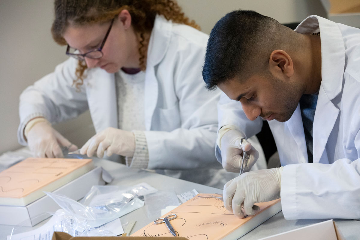 Graduate students in the Decker School completed 868 hours of simulation and practice in 2018. Here, nurse practitioner students practice suturing as part of the Advanced Skills Workshop.