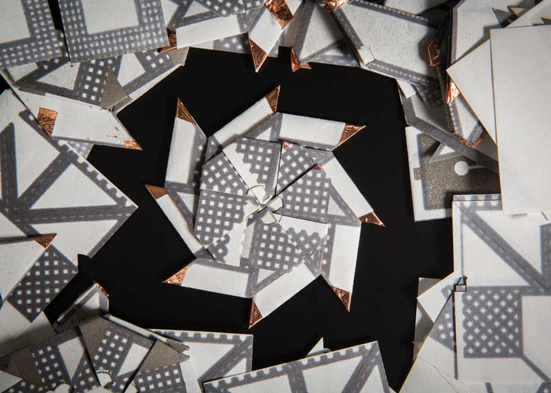Different folding and stacking methods can significantly improve power and current outputs. This version of an origami battery is based on a ninja throwing star.