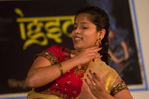 Female student dancing at event