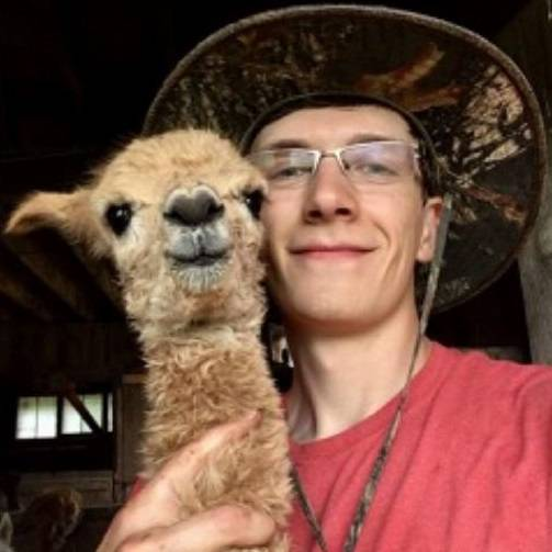 Dyllan May Poses with Baby Alpaca